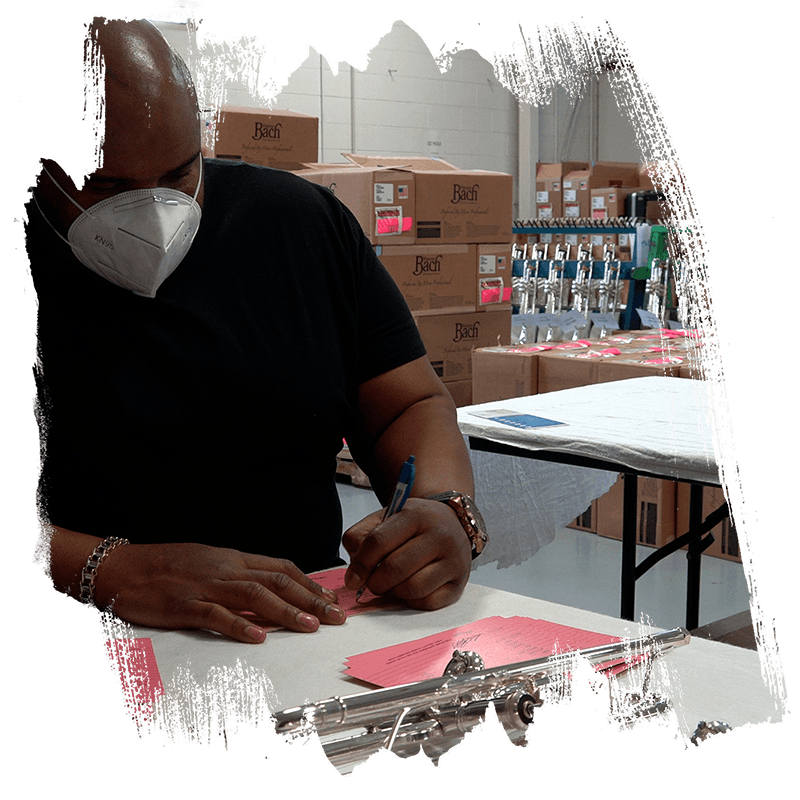 Rashawn Ross filling out shop cards for Artist Select